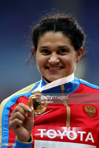 Gold medalist Tatyana Lysenko of Russia poses on the podium during the medal ceremony for the Women's Hammer Throw during Day Seven of the 14th IAAF...