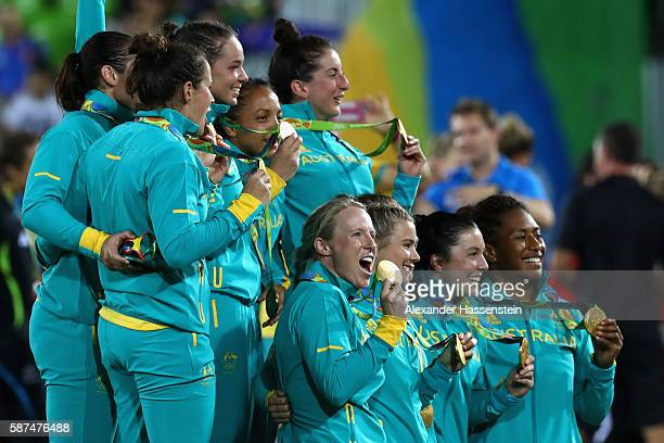Gold medalist team Australia celebrate after the medal ceremony for the Women's Rugby Sevens on Day 3 of the Rio 2016 Olympic Games at the Deodoro...