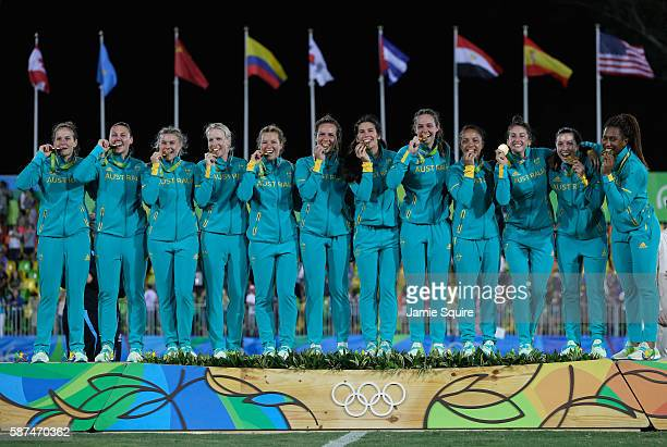 Gold medalist team Australia celebrate with their gold medal on the podium during the medal ceremony for the Women's Rugby Sevens on Day 3 of the Rio...