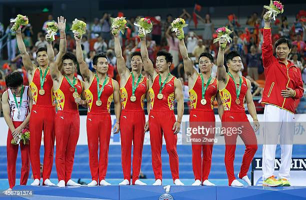 Gold medalist team of China celebrates during the medal ceremony after the Men's Team Final of the 45th Artistic Gymnastics World Championships at...