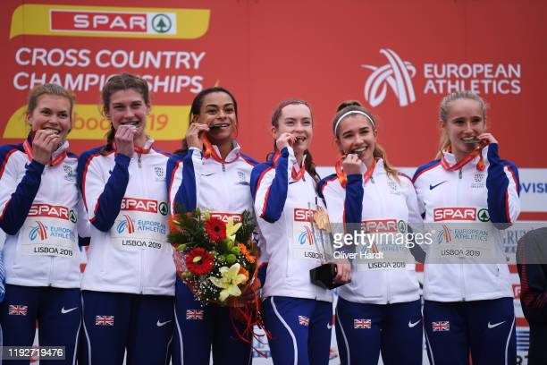 Gold Medalist Team of Great Britain reacts during the medal ceremony on the podium after finishing in the U23 Women Team at the SPAR European Cross...