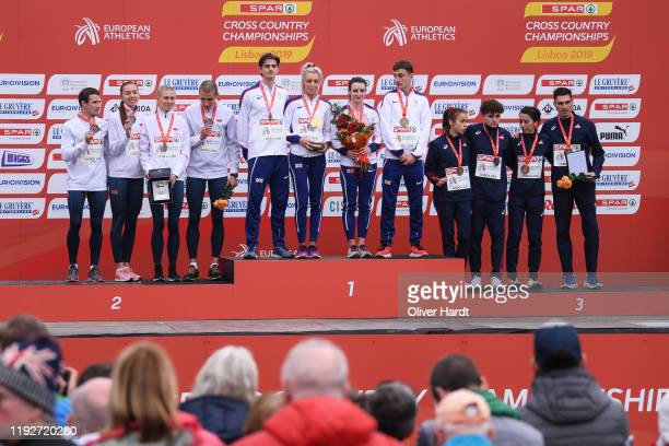Gold Medalist Team of Great Britain reacts during the medal ceremony on the podium after finishing in the Senior Relay Mixed at the SPAR European...