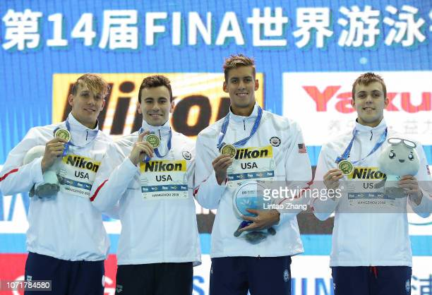 Gold medalist team of United States celebrates during medal ceremony at the men's 4x100 freestyle relay finals of the 14th FINA World Swimming...
