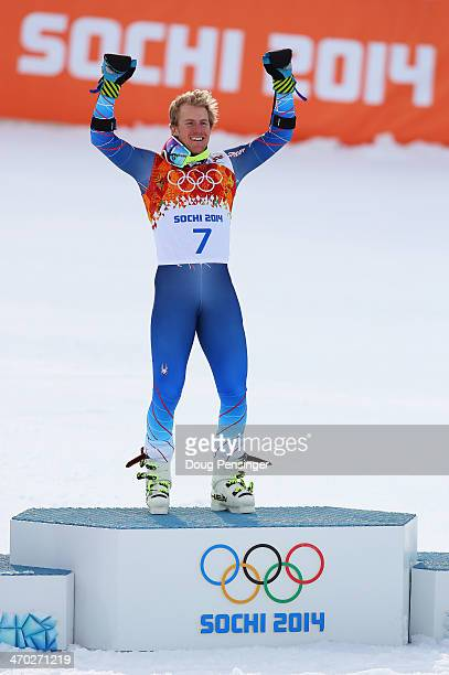 Gold medalist Ted Ligety of the United States celebrates during the flower ceremony for the the Alpine Skiing Men's Giant Slalom on day 12 of the...