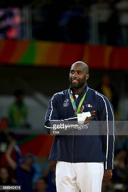 Gold medalist Teddy Riner of France celebrates on the podium after defeating Hisayoshi Harasawa of Japan during the Men's +100kg Judo Gold Medal...