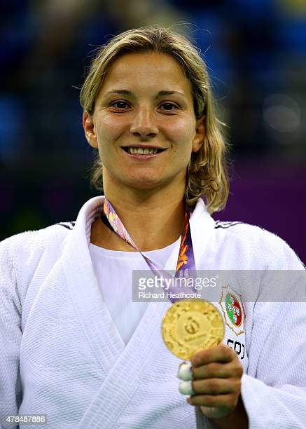 Gold medalist Telma Monteiro of Portugal poses on the medal podium following the Women's Judo 57kg Finals during day thirteen of the Baku 2015...
