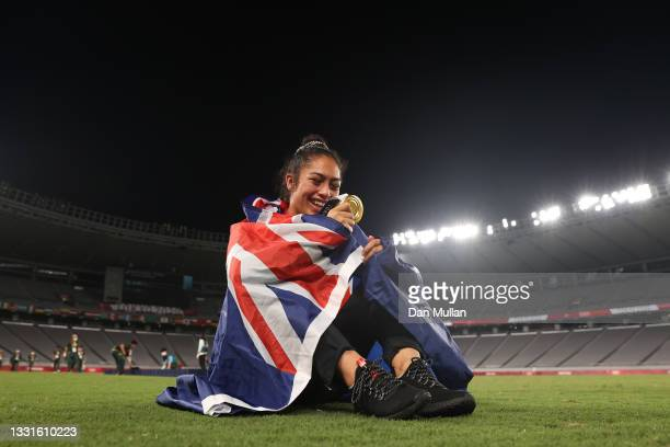 Gold medalist Tenika Willison of Team New Zealand celebrates with her gold medal after the Women's Rugby Sevens Medal Ceremony on day eight of the...