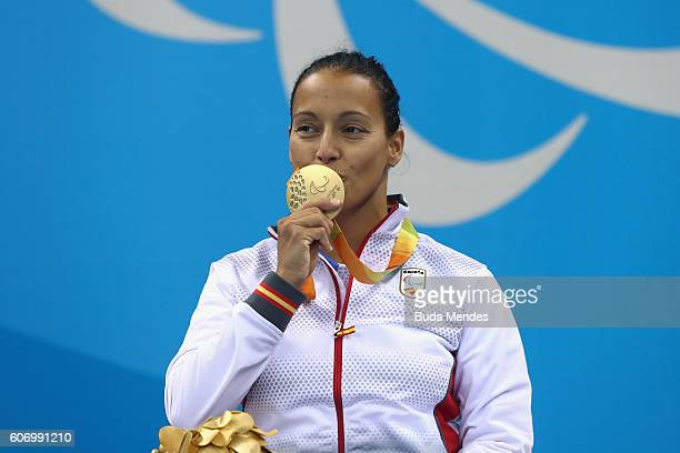 Gold medalist Teresa Perales of Spain celebrates on the podium at the medal ceremony for the Women's 50m Backstroke S5 on day 9 of the Rio 2016...