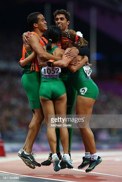 Gold medalist Terezinha Guilhermina of Brazil and her guide Guilherme Soares de Santana celebrate with Silver medalist Jerusa Geber Santos of Brazil...