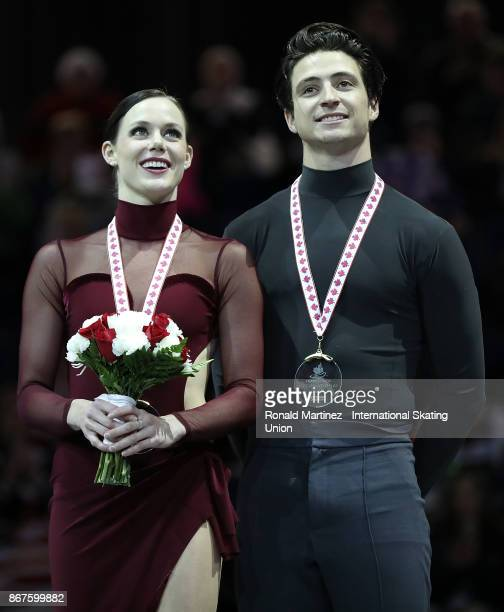 Gold medalist Tessa Virtue and Scott Moir of Canada in the victory ceremony for ice dance during the ISU Grand Prix of Figure Skating at Brandt...
