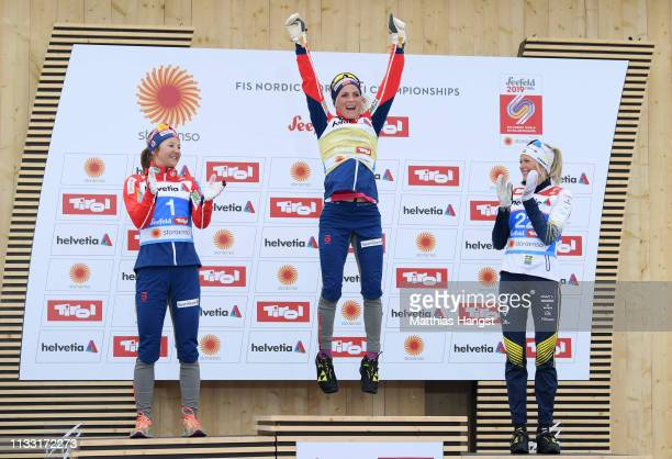 Gold medalist Therese Johaug of Norway celebrates during the flower ceremony for the Women's Cross Country 30k race during the FIS Nordic World Ski...