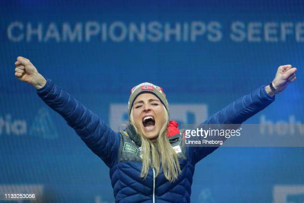 Gold medalist Therese Johaug of Norway celebrates during the Medal Ceremony for the Women's Cross Country 30k race during the FIS Nordic World Ski...
