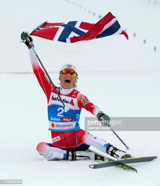Gold medalist Therese Johaug of Norway celebrates following the Women's Cross Country 30k race during the FIS Nordic World Ski Championships on March...