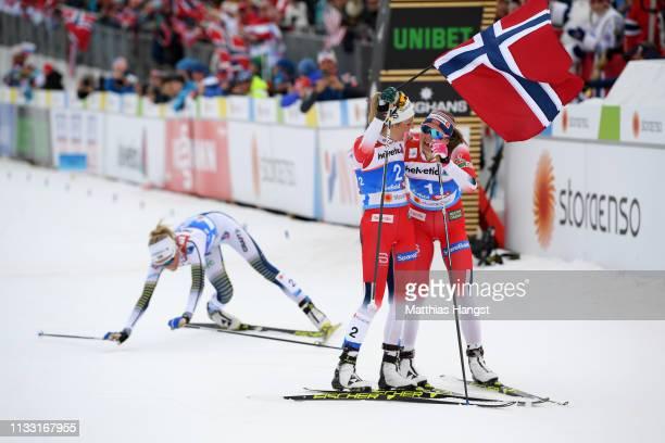 Gold medalist Therese Johaug of Norway celebrates with silver medalist Ingvild Flugstad Oestberg of Norway as bronze medalist Frida Karlsson of...
