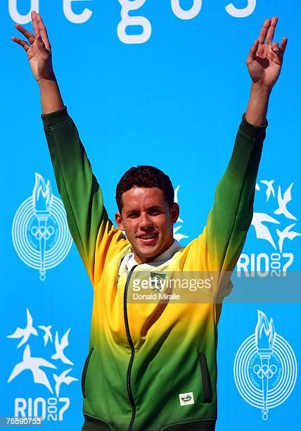 Gold medalist Thiago Pereira of Brazil celebrates on the podium before receiving his medal in the Men's 200 meter Breaststroke during the 2007 XV Pan...