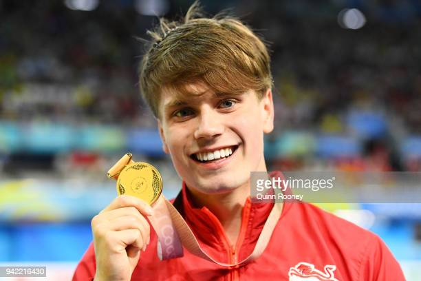 Gold medalist Thomas Hamer of England poses during the medal ceremony following the Men's S14 200m Freestyle Final on day one of the Gold Coast 2018...