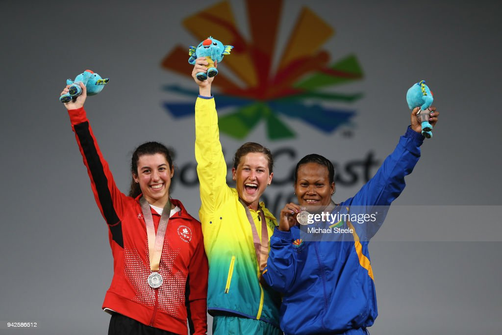 Gold medalist Tia-Clair Toomey (C) of Australia, silver medalist Tali Darsigny (L) of Canada and bronze medalist Jenly Wini (R) of Soloman Islands on the winners podium during the Women's Weightlifting 58kg on day two of the Gold Coast 2018 Commonwealth Games at Carrara Sports and Leisure Centre on April 6, 2018 on the Gold Coast, Australia.