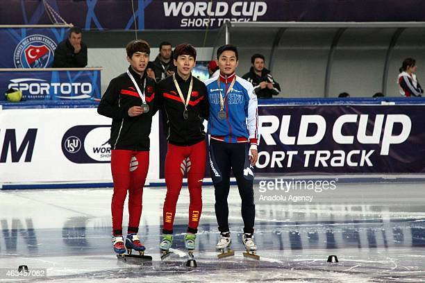 Gold medalist Tianyu Han of China Silver medalist Chen Dequan of China and Victor An of Russia pose for a picture after winning the Men's 1500m A...
