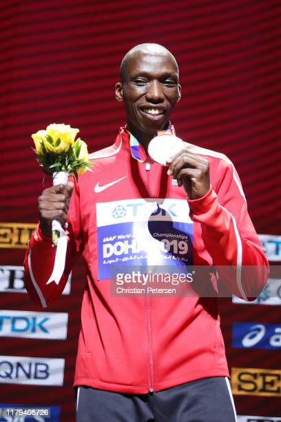Gold medalist Timothy Cheruiyot of Kenya stands on the podium during the medal ceremony for the Men's 1500 metres final during day ten of 17th IAAF...