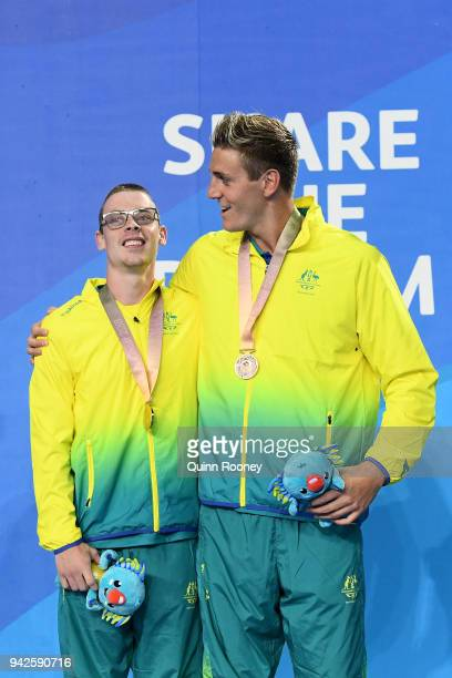 Gold medalist Timothy Disken of Australia and bronze medalist Brenden Hall of Australia pose during the medal ceremony for the Men's S9 100m...