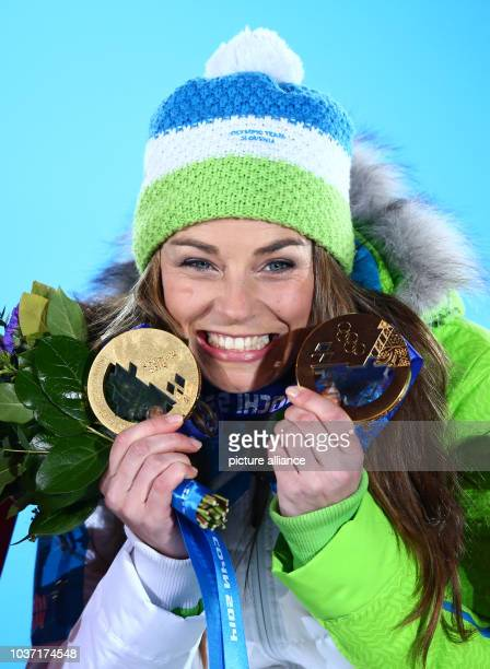 Gold medalist Tina Maze of Slovenia poses with her two gold medals for Women's Downhill and Women's Giant Slalom during the medal ceremony for the...