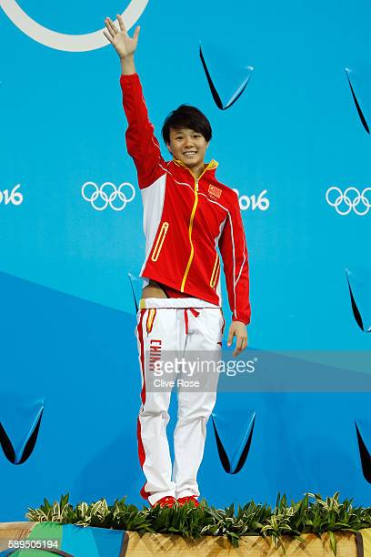 Gold medalist Tingmao Shi of China celebrates on the podium during the medal ceremony for the Women's Diving 3m Springboard Final on Day 9 of the Rio...