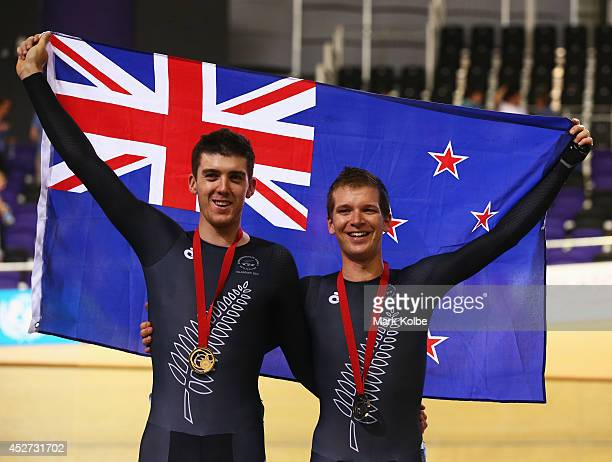 Gold medalist Tom Scully of New Zealand and bronze medalist Aaron Gate of New Zealand celebrate during the medal ceremony for the Men's 40km Points...