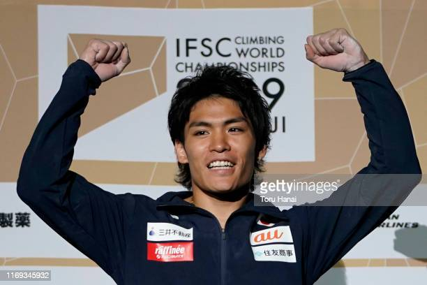 Gold medalist Tomoa Narasaki of Japan celebrates on the podium at the medal ceremony for the Combined Men's Final on day eleven of the IFSC Climbing...