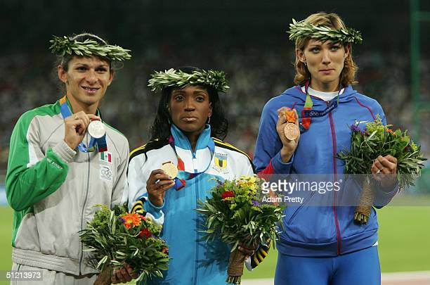 Gold medalist Tonique WilliamsDarling of Bahamas silver medalist Ana Guevara of Mexico and bronze medalist Natalya Antyukh of Russia celebrate on the...