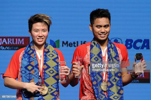Gold medalist Tontowi Ahmad and Liliyana Natsir of Indonesia celebrate on the podium during Mixed Double medals ceremony of the BCA Indonesia Open...
