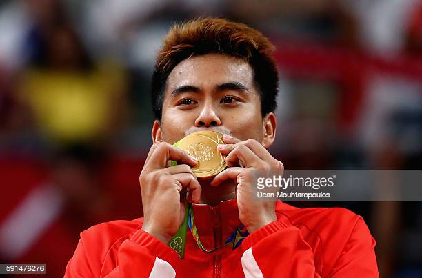 Gold medalist Tontowi Ahmad of Indonesia celebrates winning the Mixed Doubles Gold Medal Match against Peng Soon Chan and Liu Ying Goh of Malaysia on...