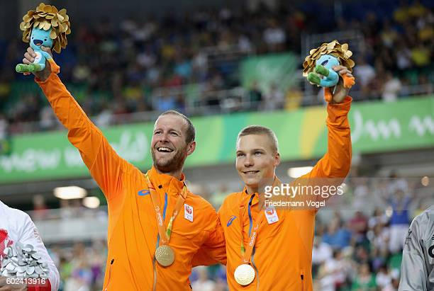 Gold medalist Tristan Bangma and Teun Mulder of Netherlands celebrate on the podium at the medal ceremony for Men's B 1000m Time Trial Track Cycling...