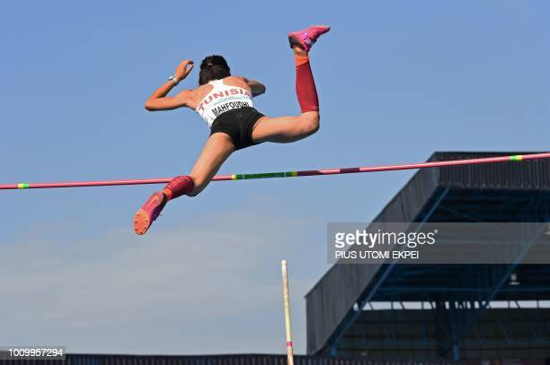 Gold medalist Tunisian Dora Mahfoudhi leaps high with a pole during the Women's Pole Vaut final at the 21st African Senior Athletics Championships at...
