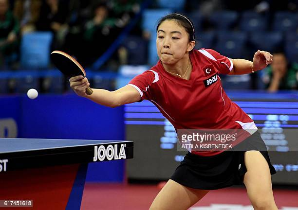 Gold medalist Turkey's Melek Hu plays against Portugal's Fu Yu in Tuskecsarnok sports hall of Budapest on October 23 2016 during the women final of...