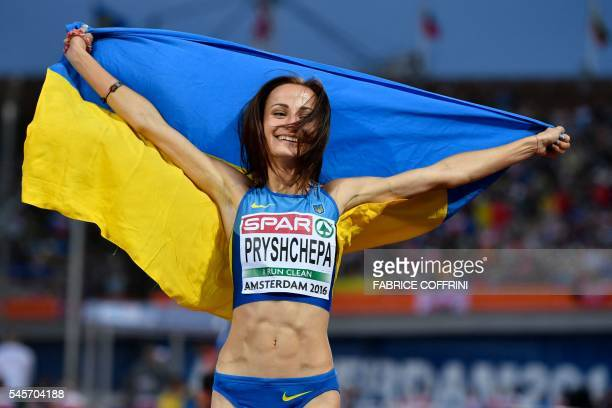 Gold medalist Ukraine's Nataliya Pryshchepa poses after winning the Women's 800m final during the European Athletics Championships at the Olympic...