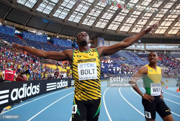 Gold medalist Usain Bolt of Jamaica celebrates with silver medalist Warren Weir of Jamaica after the Men's 200 metres final during Day Eight of the...