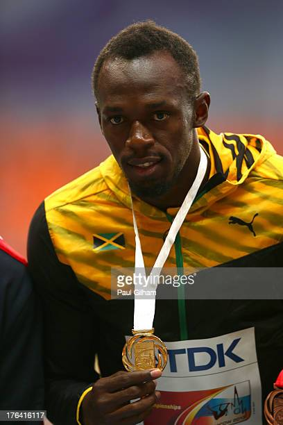 Gold medalist Usain Bolt of Jamaica on the podium during the medal ceremony for the Men's 100 metres during Day Three of the 14th IAAF World...
