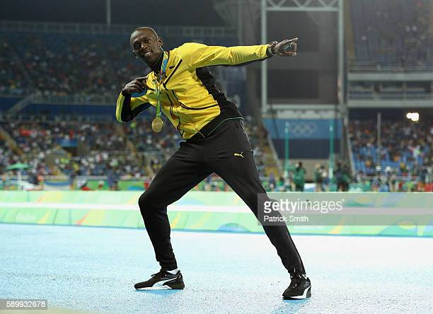 Gold medalist Usain Bolt of Jamaica poses after the medal ceremony for the Men's 100 metres on Day 10 of the Rio 2016 Olympic Games at the Olympic...