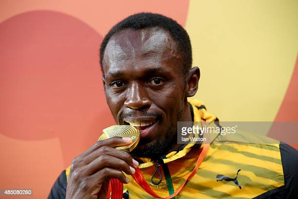 Gold medalist Usain Bolt of Jamaica poses during the medal ceremony for the Men's 100 metres final during day three of the 15th IAAF World Athletics...