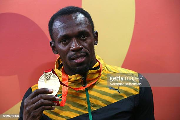 Gold medalist Usain Bolt of Jamaica poses following the medal ceremony for the Men's 200 metres final during day seven of the 15th IAAF World...