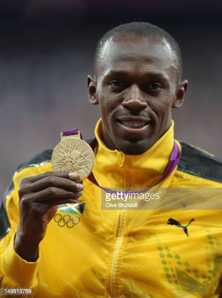 Gold medalist Usain Bolt of Jamaica poses on the podium during the medal ceremony for the Men's 100m final on Day 10 of the London 2012 Olympic Games...