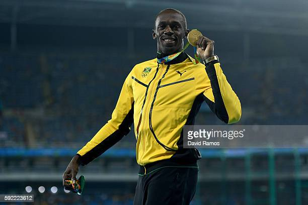 Gold medalist, Usain Bolt of Jamaica, poses on the podium during the medal ceremony for the Men's 200m on Day 14 of the Rio 2016 Olympic Games at the...