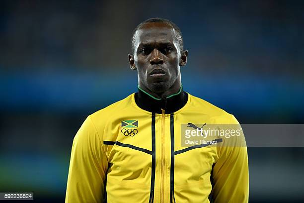 Gold medalist Usain Bolt of Jamaica poses on the podium during the medal ceremony for the Men's 200m on Day 14 of the Rio 2016 Olympic Games at the...