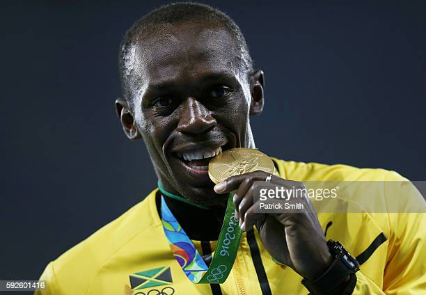 Gold medalist Usain Bolt of Jamaica stands on the podium during the medal ceremony for the Men's 4 x 100 meter Relay on Day 15 of the Rio 2016...