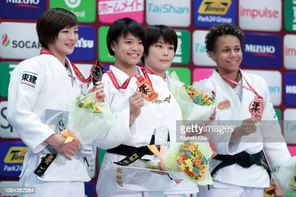 Gold medalist Uta Abe of Japan celebrates with silver medalist Natsumi Tsunoda of Japan and bronze medalists Ai Shishime of Japan and Amandine...