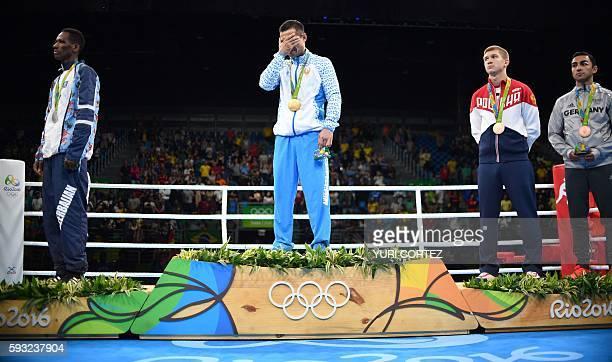 Gold medalist Uzbekistan's Fazliddin Gaibnazarov silver medalist Azerbaijan's Lorenzo Sotomayor Collazo and bronze medalists Russia's Vitaly...