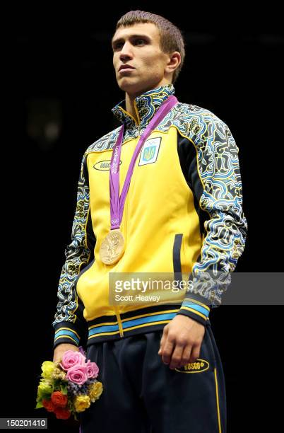 Gold medalist Vasyl Lomachenko of Ukraine celebrates on the podium during the medal ceremony for the Men's Light Boxing final bout on Day 16 of the...