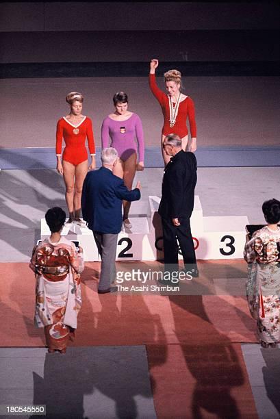 Gold Medalist Vera Caslavska of Czechoslovakia Silver Medalists Larysa Latynina of Soviet Union and Birgit Radochla of Germany on the podium during...
