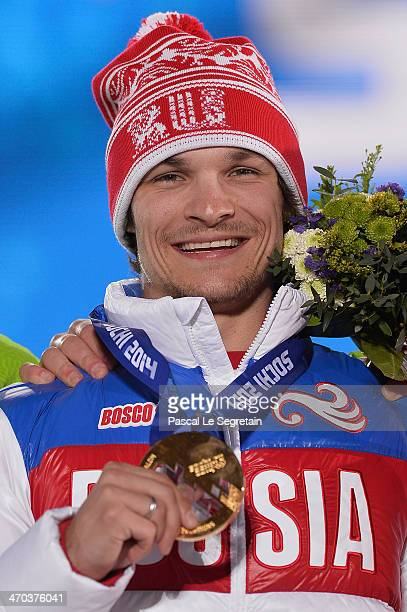 Gold medalist Vic Wild of Russia celebrates during the medal ceremony for the Men's Parallel Giant Slalom on day twelve of the Sochi 2014 Winter...
