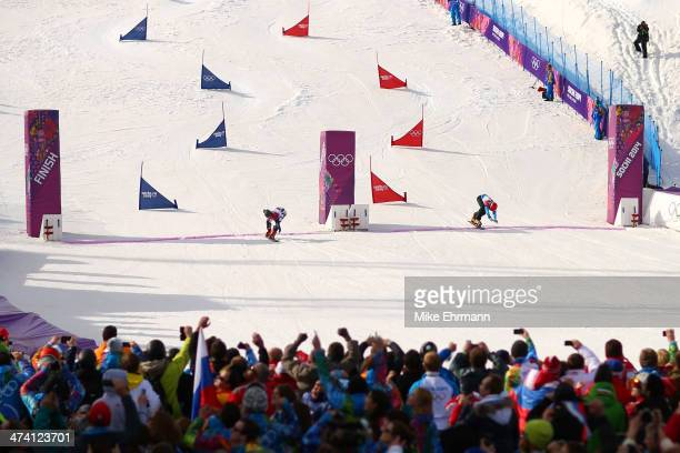 Gold medalist Vic Wild of Russia crosses the line ahead of silver medalist Zan Kosir of Slovenia in the Snowboard Men's Parallel Slalom Big Final on...